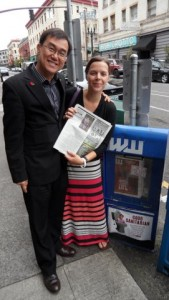 Abby reading press coverage with Jack Sim